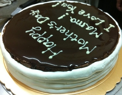 Chocolate Mousse Cake With Cream On The Sides And Words On The Top