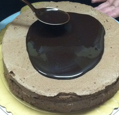 Pouring Liquid Chocolate On Sponge Cake